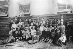 School children and teachers Miss M.Betts and E.A. Smith outside the Bramley Group School