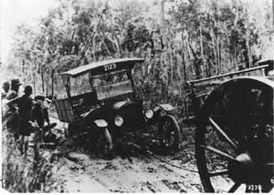 Bogged Group truck being pulled out by horse and cart. Roads were impassable in the winter